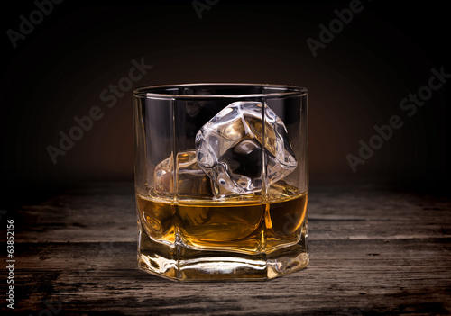 Glasses of whiskey on wood background. - 63852156
