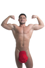 Smiling young naked man posing biceps straining
