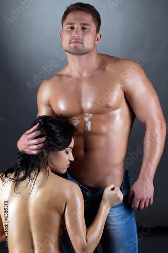 Tanned passionate spouses posing at camera