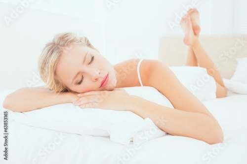 Sleeping young blonde lying on her bed