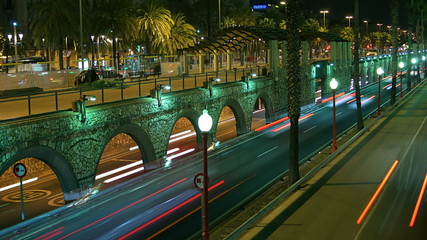 Urban scene of traffic on a major road at dusk in Barcelona, Spa