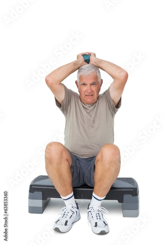 Full length portrait of a senior man exercising