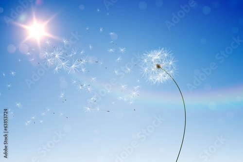Digitally generated dandelions against blue sky