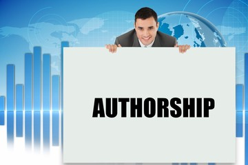 Businessman showing card saying authorship