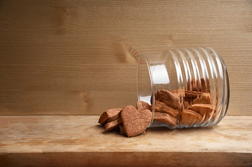 Inverted sheer jar with chocolate cookies in the shape of heart