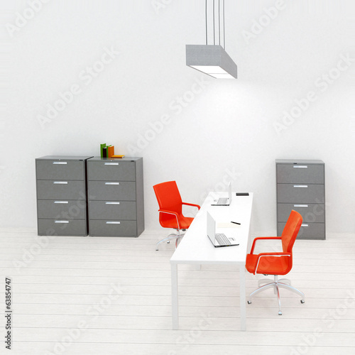 Interior of small modern office with orange accent