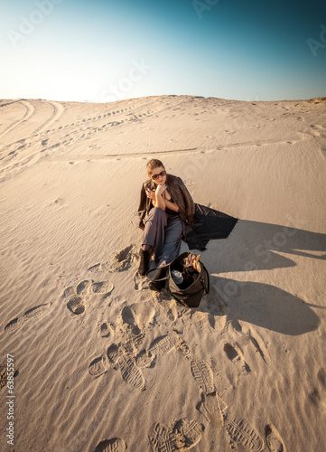 woman with bag lost in desert