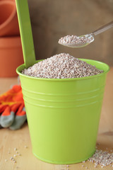 Fertilizer in green bucket