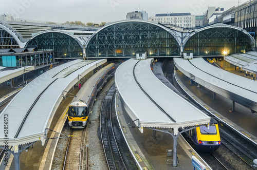 Train leaves Paddington railway station in London, UK