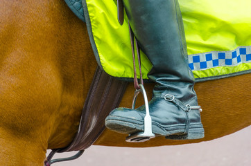 Detail of boots of British policeman on horseback in London