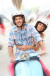 Cheerful couple riding blue moto