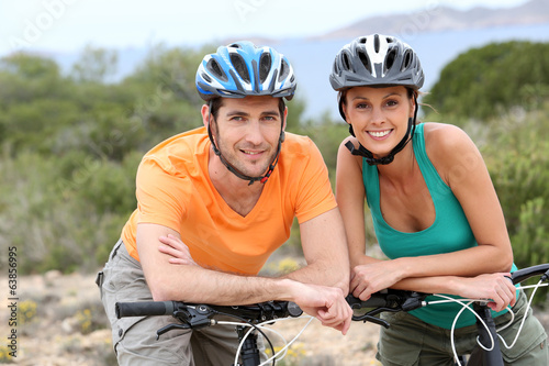 Portrait of couple on a biking day in Ibiza island