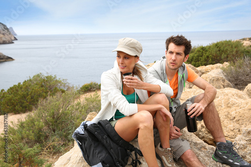 Couple having a break during hiking journey