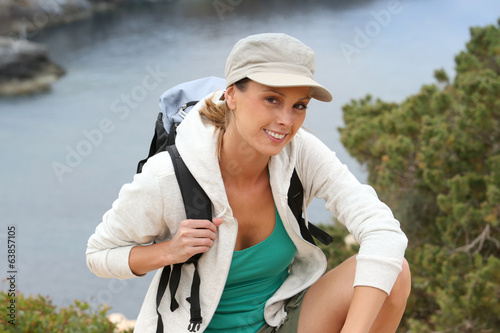 Portrait of cheerful hiking girl