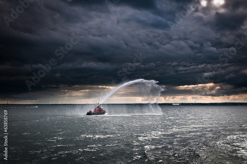 fireboat demonstrating its capabilities on Baltic Sea in Gdansk