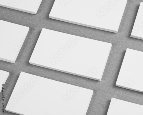blank business cards on gray background