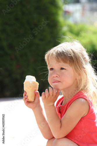 beautiful little girl eating ice cream