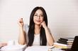 canvas print picture - Studentin mit Brille am Schreibtisch