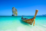 Fototapety Cliff and boat in the amazing beach in tropical island in Krabi, Phuket, Thailand