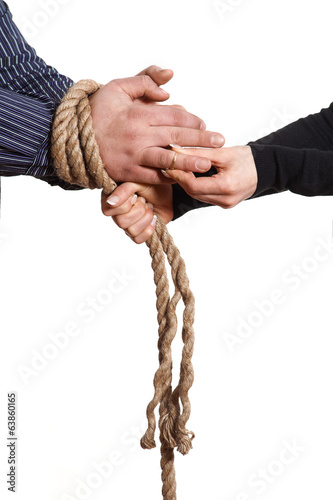 Close up of hands tied with rope