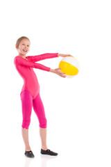 Little gymnastics girl posing with a ball.