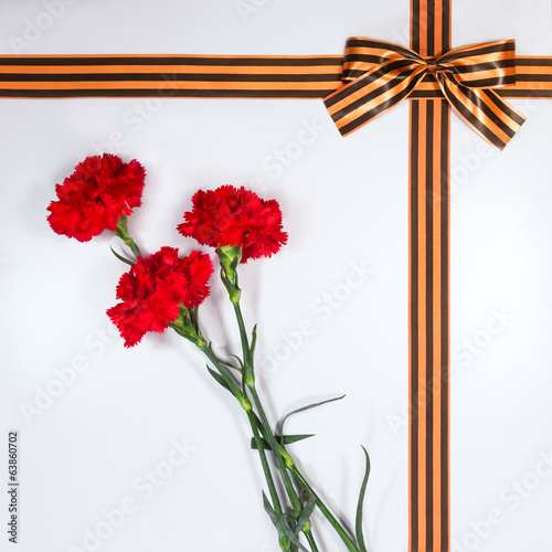 Red carnations tied Georgievsky tape