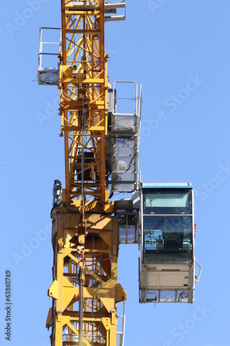 Part of tower crane on the blue sky background