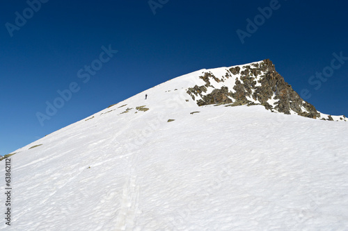 Alpinist towards the summit