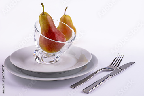 Table set with pears white background