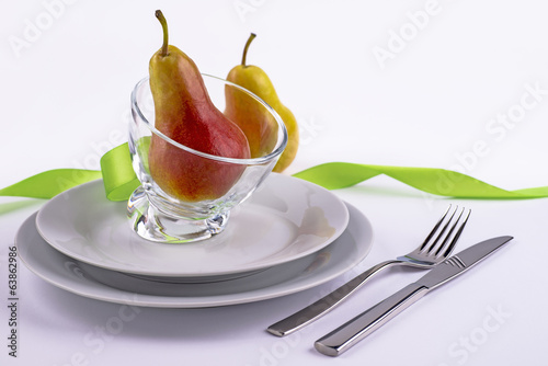Celebration table set with pears and ribbon