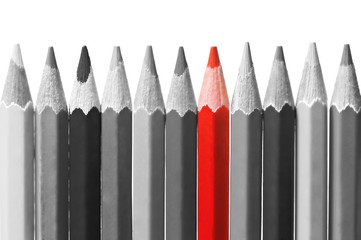 Red pencil among black and white