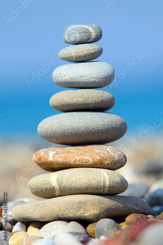 Stones over blue sky and sea