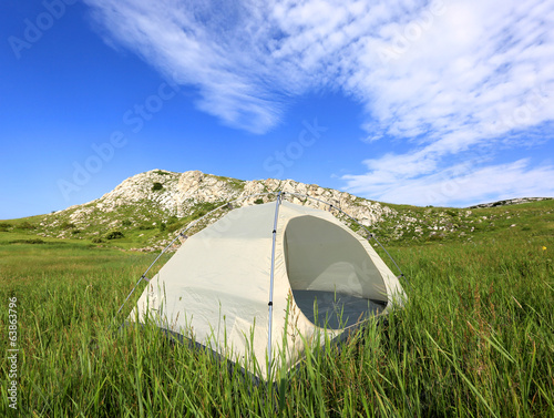 tourist tent on meadow