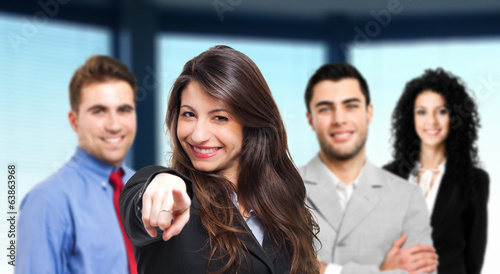 Businesswoman pointing at you in front of her team