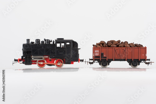 toy black locomotive and coffee