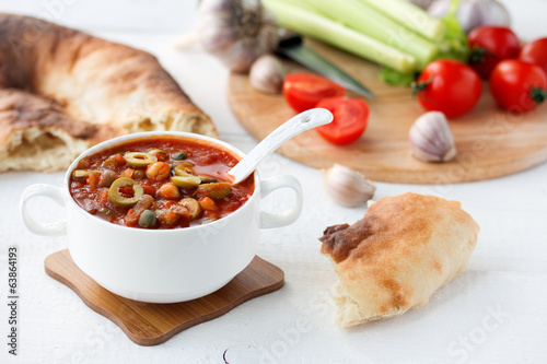 vegetable soup in white bowl on wooden table
