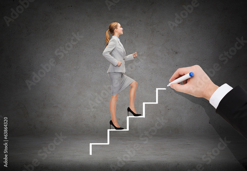 smiling businesswoman stepping up staircase