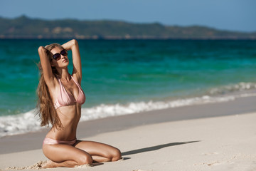 Bronze Tan Woman Sunbathing At Tropical Beach