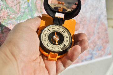 The compass in his hand