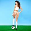 Beautiful busty woman soccer player in lingerie