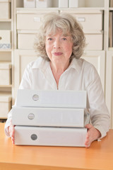 Pleased woman with files folders