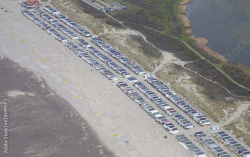 Typical Dutch beachhouses at beach from above, The Netherlands