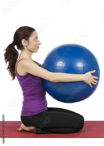 Fitness woman with a pilates ball, vertical