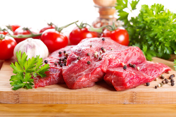 raw meat with herbs and vegetables