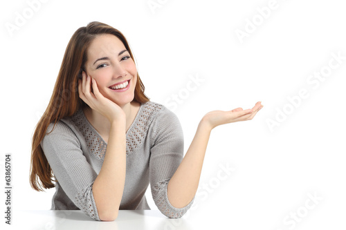 Happy woman presenting with open hand holding something blank