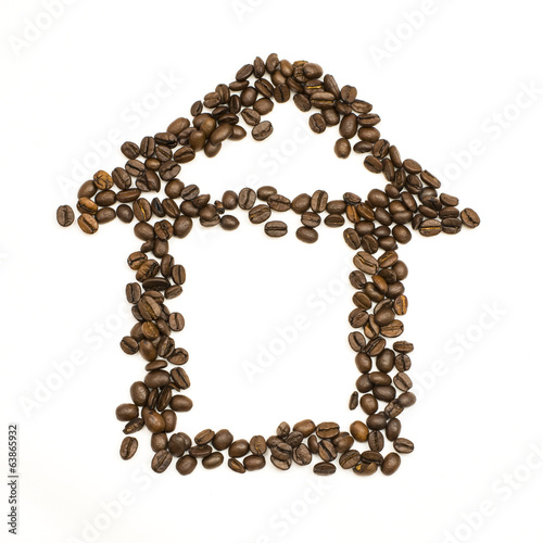Coffee beans are stacked in the shape of house