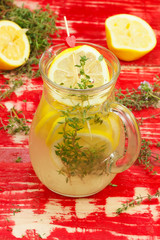 Lemon juice. Lemonade in a Glass Pitcher with Fresh Lemon Slices