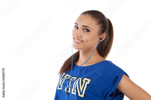 Girl in tracksuit listening to music