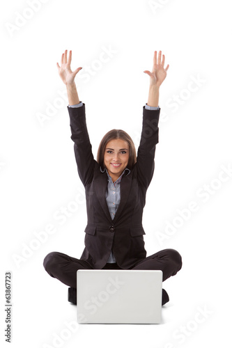 Young businesswoman sitting in yoga pose with laptop