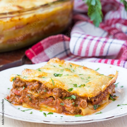 Homemade lasagna with Bolognese meat sauce Bechamel, serving